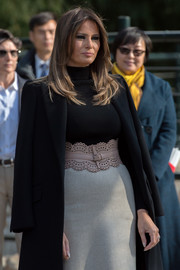Melania Trump styled her look with an oversized laser-cut belt by Alaia.