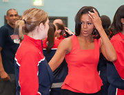 Michelle Obama sported a feminine silhouette with this coral peplum top as she welcomed members of the 2012 USA Olympic team.