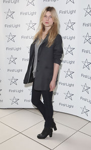 Clemence pays homage to effortless style in a charcoal blazer at the First Light Movie Awards.