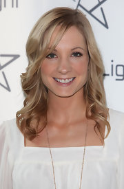 Joanne Froggatt added a little bounce to her look with long curls that she swept to the side.