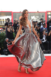 Izabel Goulart drew admiring stares in a plunging silver gown by Alberta Ferretti at the 2018 Venice Film Festival opening ceremony.