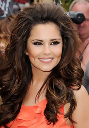 Cheryl Cole pumped up the volume for her first appearance as an X Factor Judge. With voluminous curls and a teased crown, Cheryl's hairstyle was full of height and dimension.