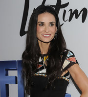 Demi Moore shined at the NYC screening of 'Five'. To get her lustrous locks, try spritzing tresses with a small amount of a shine-enhancing product. We recommend Carol's Daughter Macadamia Finishing Shine Mist.