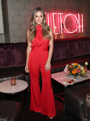 JoJo Fletcher gave us '70s vibes with this red bell-bottom jumpsuit at the Fletch X Joelle Fletcher launch party.