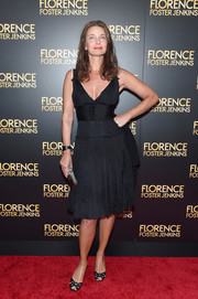 Paulina Porizkova complemented her dress with a pair of black cutout peep-toes.