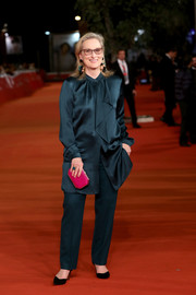Meryl Streep coordinated her blouse with a pair of teal silk pants.
