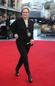 Meryl Streep complemented her jumpsuit with a pair of black ankle boots.