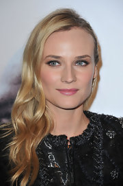 To bring out her blue eyes, Diane Kruger used a palette of warm eyeshadow colors like bronze, copper and gold. Applying eye makeup in complementary shades always makes eye color pop. For green or hazel eyes try purples and plums and for brown eyes all shades of blue work beautifully.