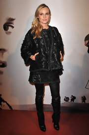 Diane Kruger kept warm in Paris wearing black leather pants under a tweed mini skirt.