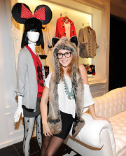 Renee fearlessly rocked a quirky fur hat with ears and long ear flaps that turn into scarves.