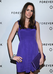 Louise Roe matched her silky purple frock with a diamond print envelope clutch.