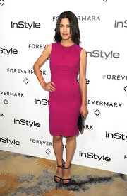 Julia Jones paired her berry-colored sheath dress with black strappy sandals.