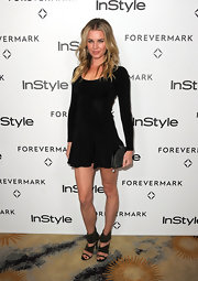 Rebecca Romijn wore a flouncy knit LBD for the InStyle Golden Globe event.