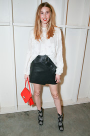 Whitney Port gave her ladylike blouse a dose of edge with a black leather mini skirt by Zara.