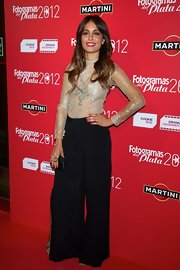 Hiba Abouk kept her look super classic and chic with black wide-legged pants.