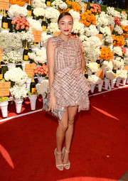 Ashley Madekwe injected some glamorous shine with a silver envelope clutch by Jimmy Choo.