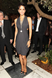 Actress Halle Berry attended the 4th Annual Women in Film Pre-Oscar Cocktail Party wearing oxidized sterling silver and rose cut diamond long layering necklaces.
