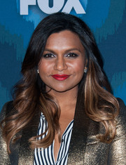 Mindy Kaling punctuated her look with a bold red lip.
