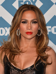Jennifer Lopez brightened up her look with a bold red lip color.