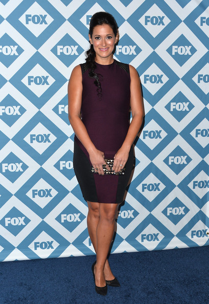 Angelique Cabral squeezed into a tight-fitting purple and black sheath for the Fox All-Star party.