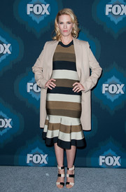 January Jones added a mannish touch with a boxy beige coat.