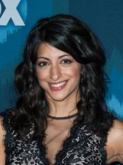 Meera Rohit Kumbhani wore voluminous, tight waves with side-swept bangs during the Fox All-Star party.
