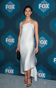 Morena Baccarin looked alluring at the Fox All-Star party in a pale-gray Halston Heritage slip dress featuring an asymmetrical neckline and hem.
