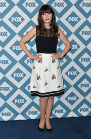 Zooey Deschanel went for a youthful vibe at the Fox All-Star party in a sheer-panel Andrew Gn dress with a floral skirt.