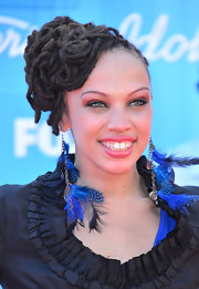 Naima Adedapo wore her long locks in a voluminous mass of coiled stands for the 2012 'American Idol' finale.