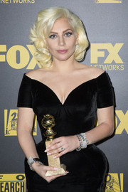 Lady Gaga piled on a load of Neil Lane diamond bracelets for the Golden Globes.
