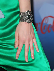 Didi's silver bracelet featured a centered green gemstone.