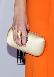 Celine Buckens' gold satin clutch at the Golden Globe party was oh-so-elegant in its simplicity.