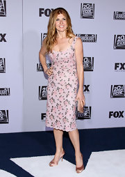 Connie Britton teamed her ultra-girly pink dress with a rose satin clutch and matching pumps.