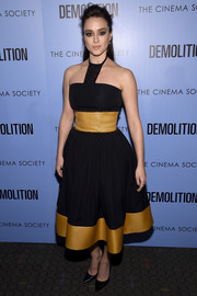 Heather Lind cut a flirty silhouette in this black and marigold halter dress by Sophie Theallet at the screening of 'Demolition.'