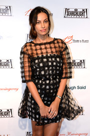Madalina Diana Ghenea sported a youthful vibe at the Fox Searchlight TIFF party in a black-and-white mini dress with a patterned sheer overlay.