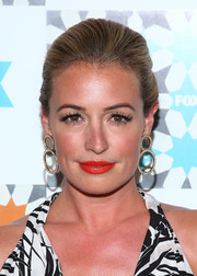 Super red lipstick finished off Cat Deeley's look in sexy style.