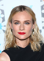 Diane Kruger topped off her look with modern black-and-white geometric earrings.