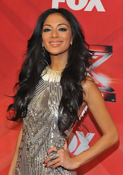 Nicole Scherzinger added a touch of classic red to her ensemble with a bit of scarlet nail polish during 'The X Factor' season finale.