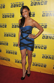 Melody flaunted her figure in a sexy strapless,studded, bandage dress.