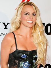 Britney wore her bottle-blonde tresses in loose waves for 'The X Factor' viewing party in 2012.