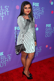 For her arm candy, Mindy Kaling chose a bejeweled and quilted black bag by Miu Miu.