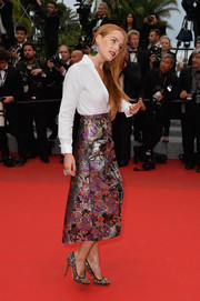Riley Keough dressed up her button-down with a gorgeous jacquard skirt by Valentino.