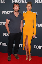 Sam Worthington opted for a casual v-neck t-shirt for his red carpet appearance at the Foxtel launch.