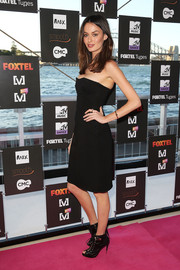 Nicole Trunfio looked classic and sexy in a strapless LBD at the Foxtel Music Channels summer launch.