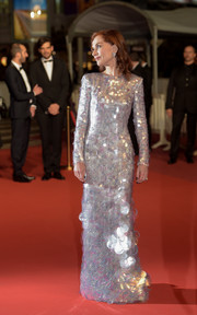 Isabelle Huppert looked supremely elegant in a silver paillette gown by Armani Prive at the 2019 Cannes Film Festival screening of 'Frankie.'