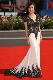 Liang Jingke was classic and glam in a black-and-white lace-accented fishtail gown at the Venice Film Festival premiere of 'Frantz.'