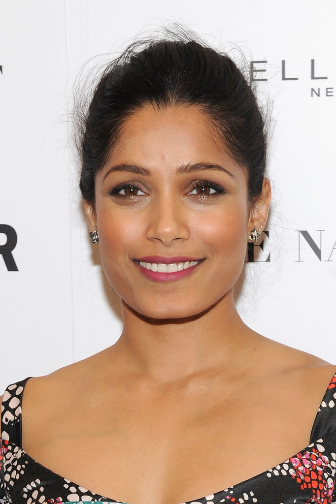 Freida Pinto kept it simple and classic with this updo at the Girl Project  event.