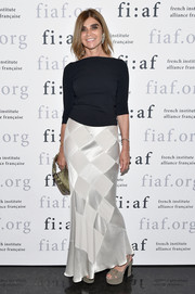 Carine Roitfeld received the 2017 Art de Vivre Award wearing a harlequin-patterned white maxi skirt and a black boatneck sweater.