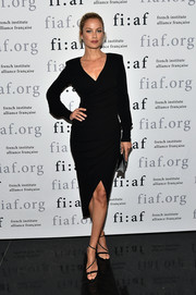 Carolyn Murphy's strappy black heels were the perfect finishing touch to her sophisticated look.