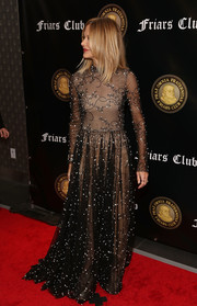 Meg Ryan looked ultra glam in a sheer, floral-embroidered black gown with a nude underlay at the Friars Club event honoring Billy Crystal.